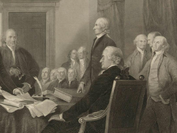 America's founding fathers sitting at a desk