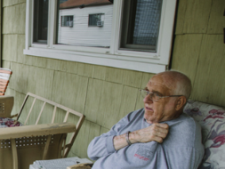 elder man sitting on porch