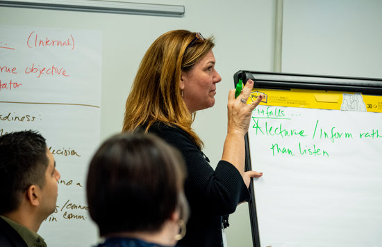 woman giving a presentation at certificate training