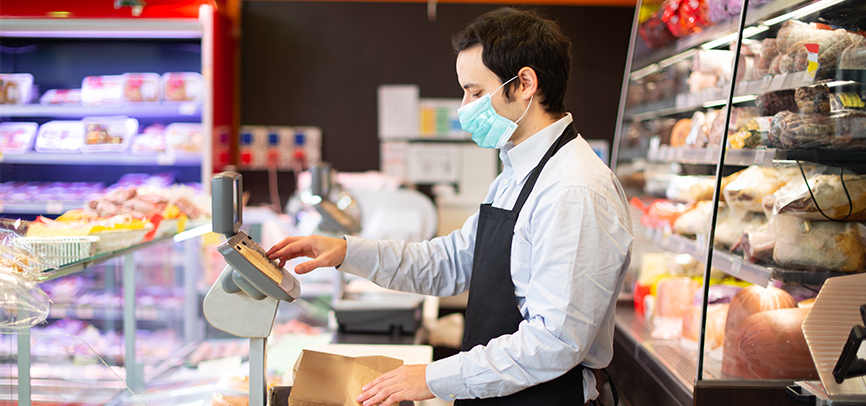 Cashier wearing mask at grocery store