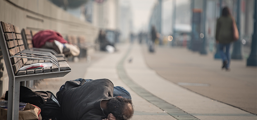 Homeless person sleeping on the ground
