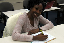 A student takes notes - Pepperdine University