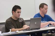 Students working with a computer - Pepperdine University