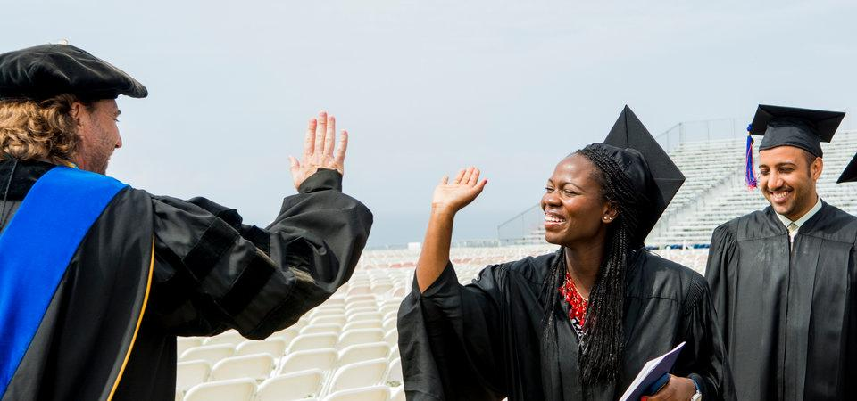 School of Public Policy Faculty Member Gives Student a High-Five at Graduation