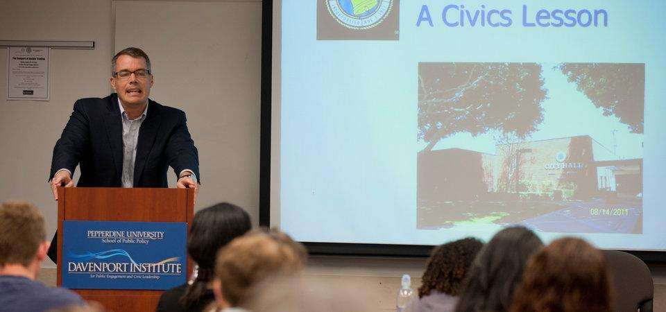 Dean Pete Peterson Standing at a Podium Providing a Training on Civic Leadership