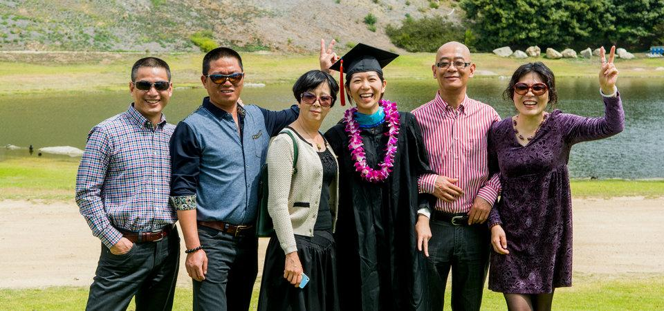 School of Public Policy Graduate with Enthusiastic Family Members